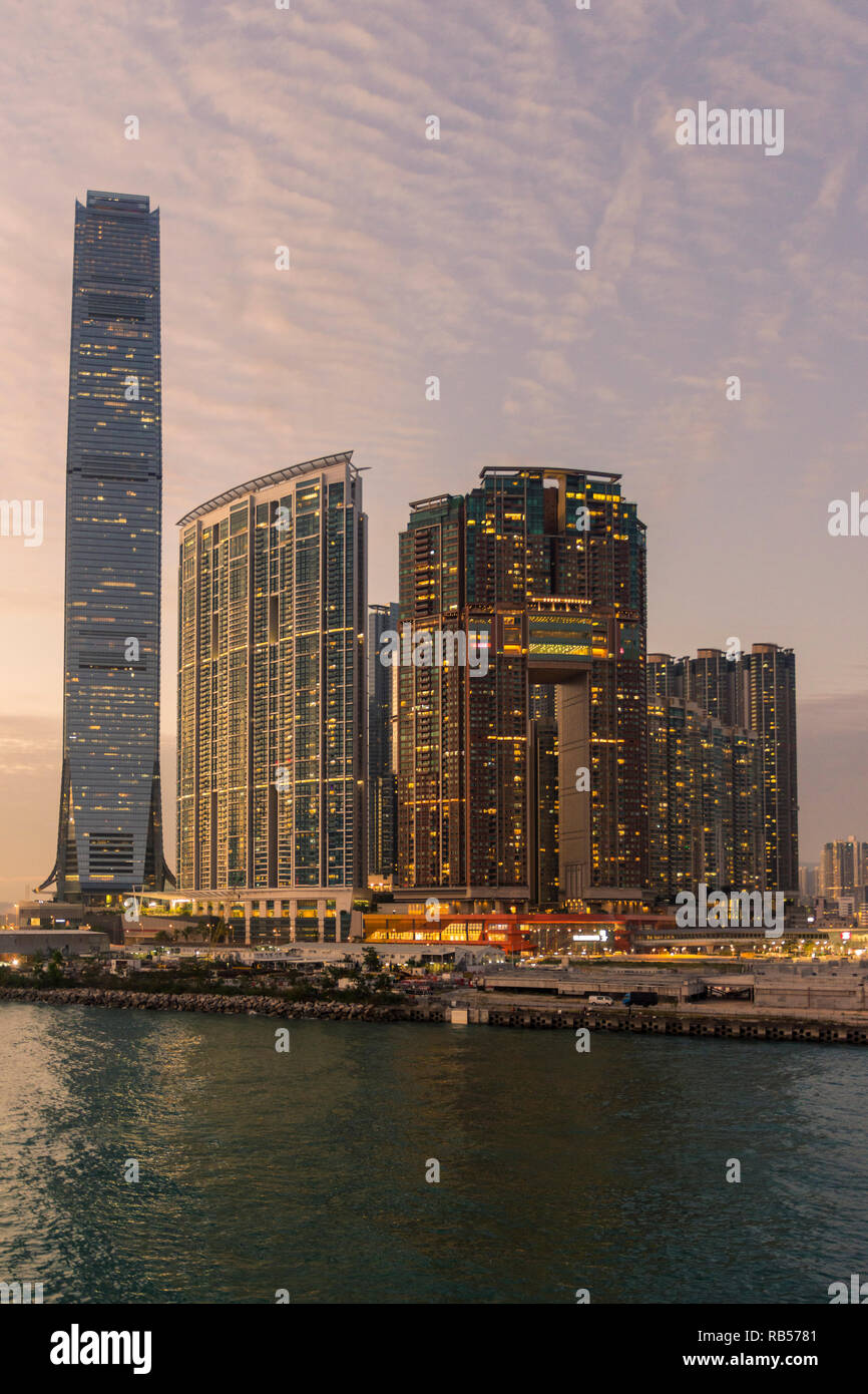 Sunset over Hong Kong development of Union Square including the International Commerce Centre, The Harbourside and The Arch, West Kowloon, Hong Kong - Stock Image