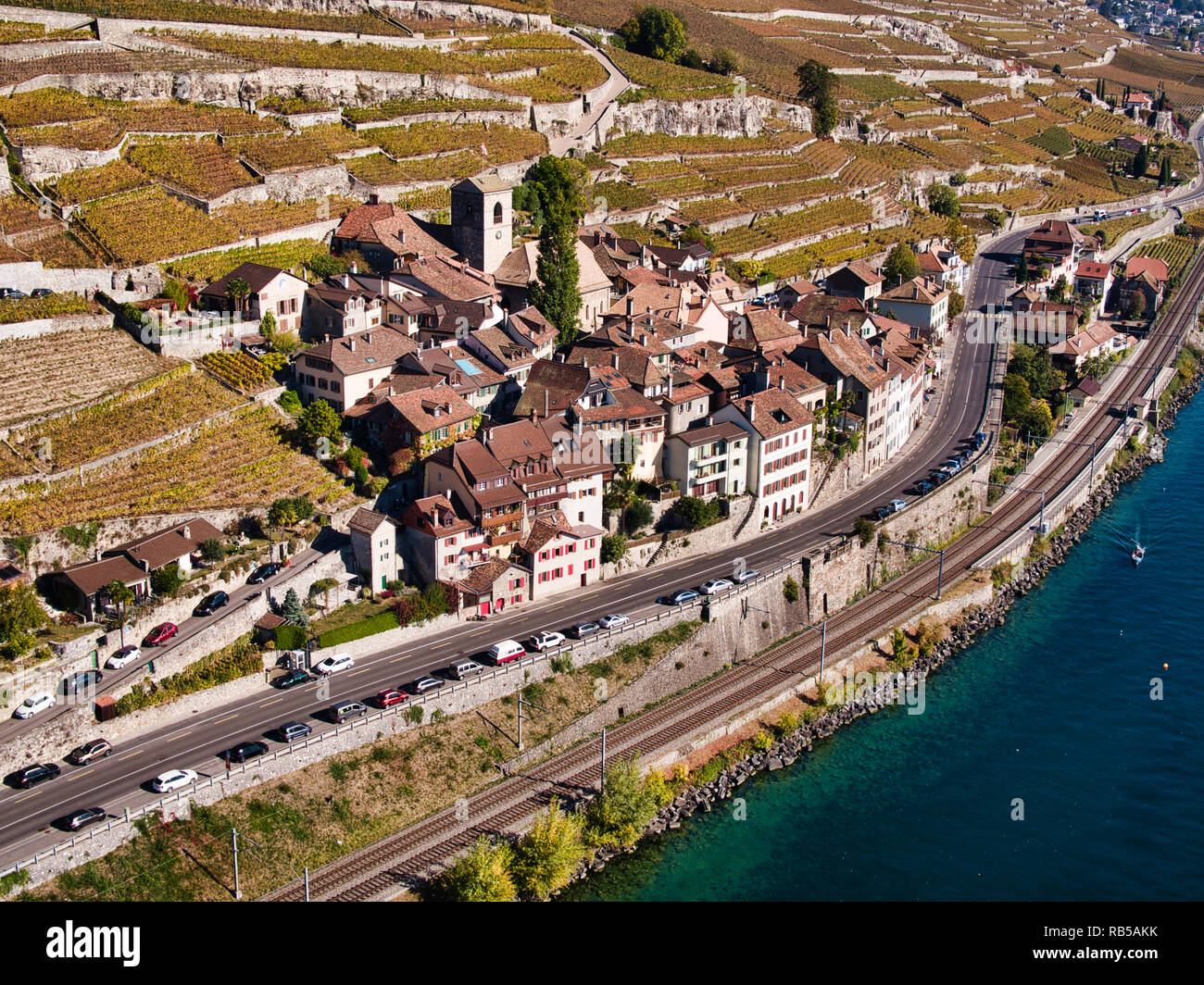 The Swiss Winemaker Village of  Saint-Saphorin in the UNESCO world cultural heritage area Lavaux on the shore of Lake Geneva seen in a drone photograp - Stock Image