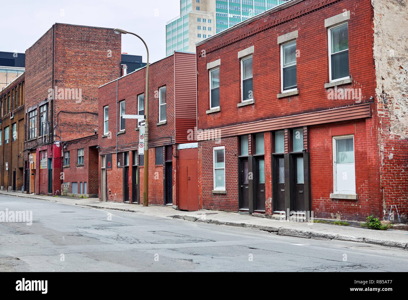 Old red brick buildings on the street in Montreal, Quebec, Canada. Editorial Stock Photo