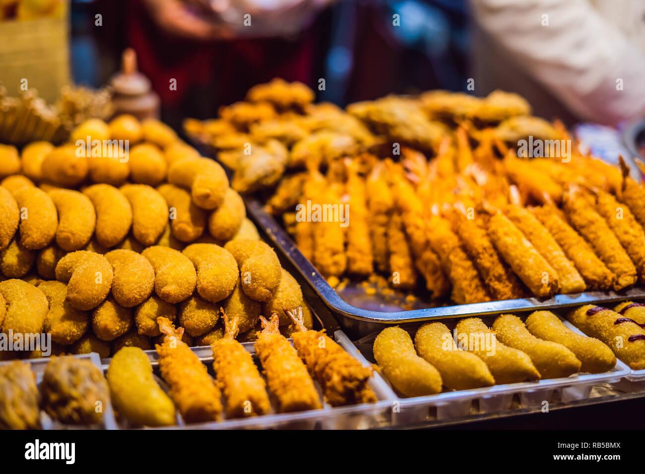 Deep fried food, street food Wangfujing night market - Stock Image