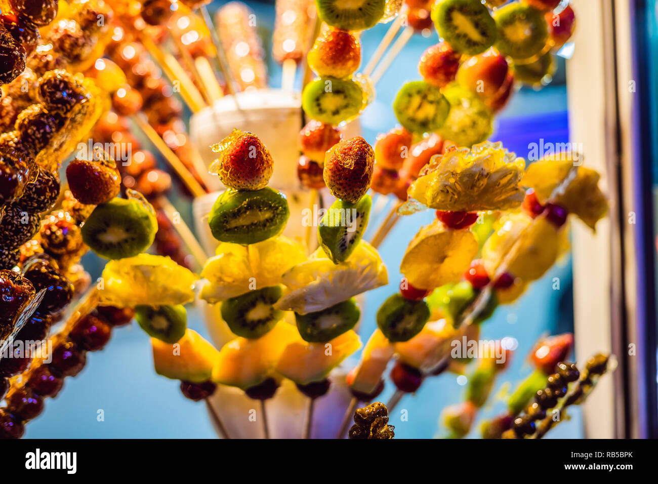 Traditional Chinese Dessert - Candied Fruit on a Wooden Stick - Stock Image