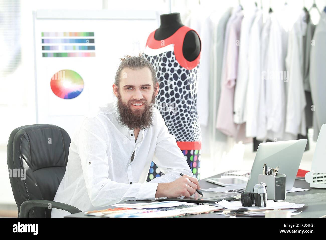 Fashion Designer Uses A Graphics Tablet To Create Sketches Of Clothes Stock Photo Alamy