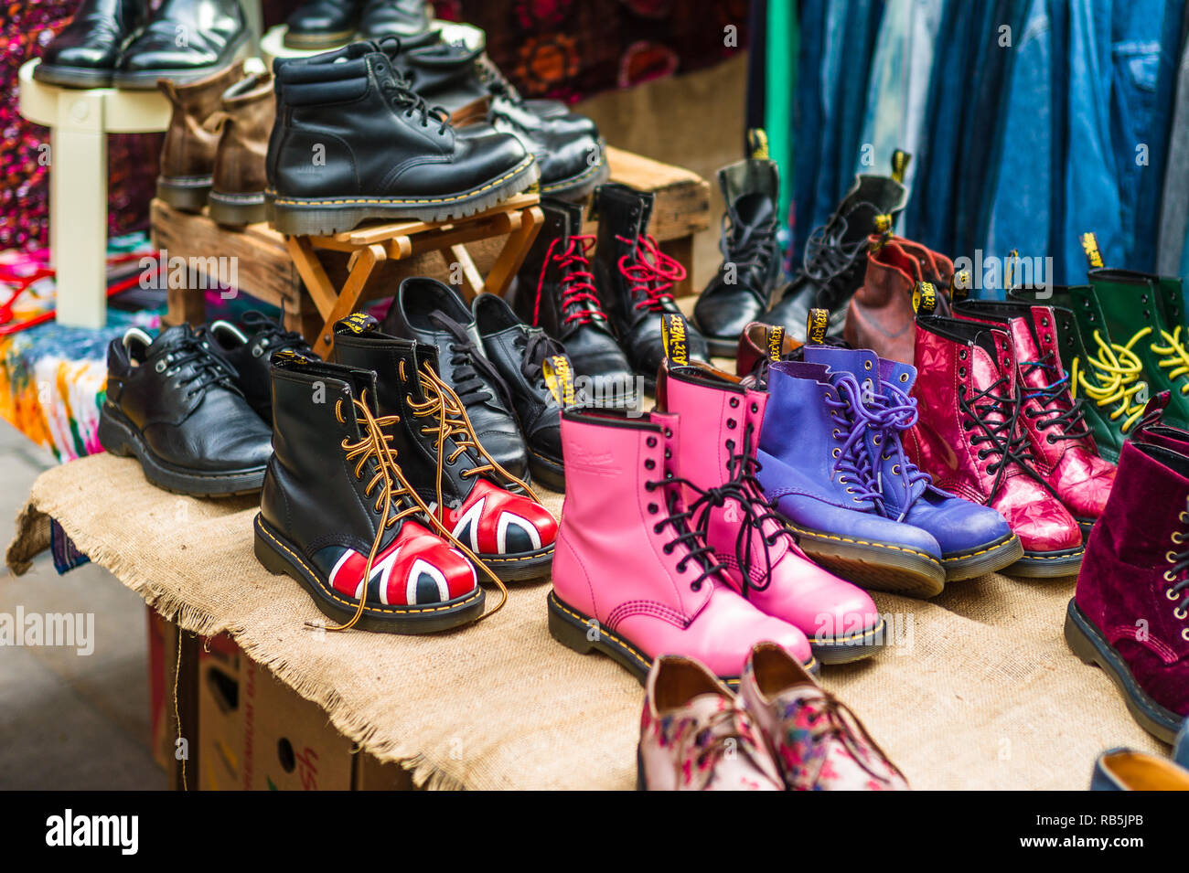 Vintage Footwear - Vintage Dr Martens boots for sale in Brick Lane Sunday Market in Shoreditch East London - Stock Image