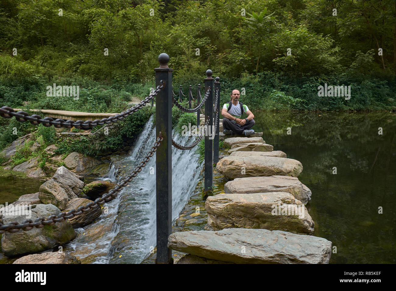 Man In Meditation At Beautiful Waterfall In Nature On Rock Brige In Wudangshan Mountains China Stock Photo Alamy