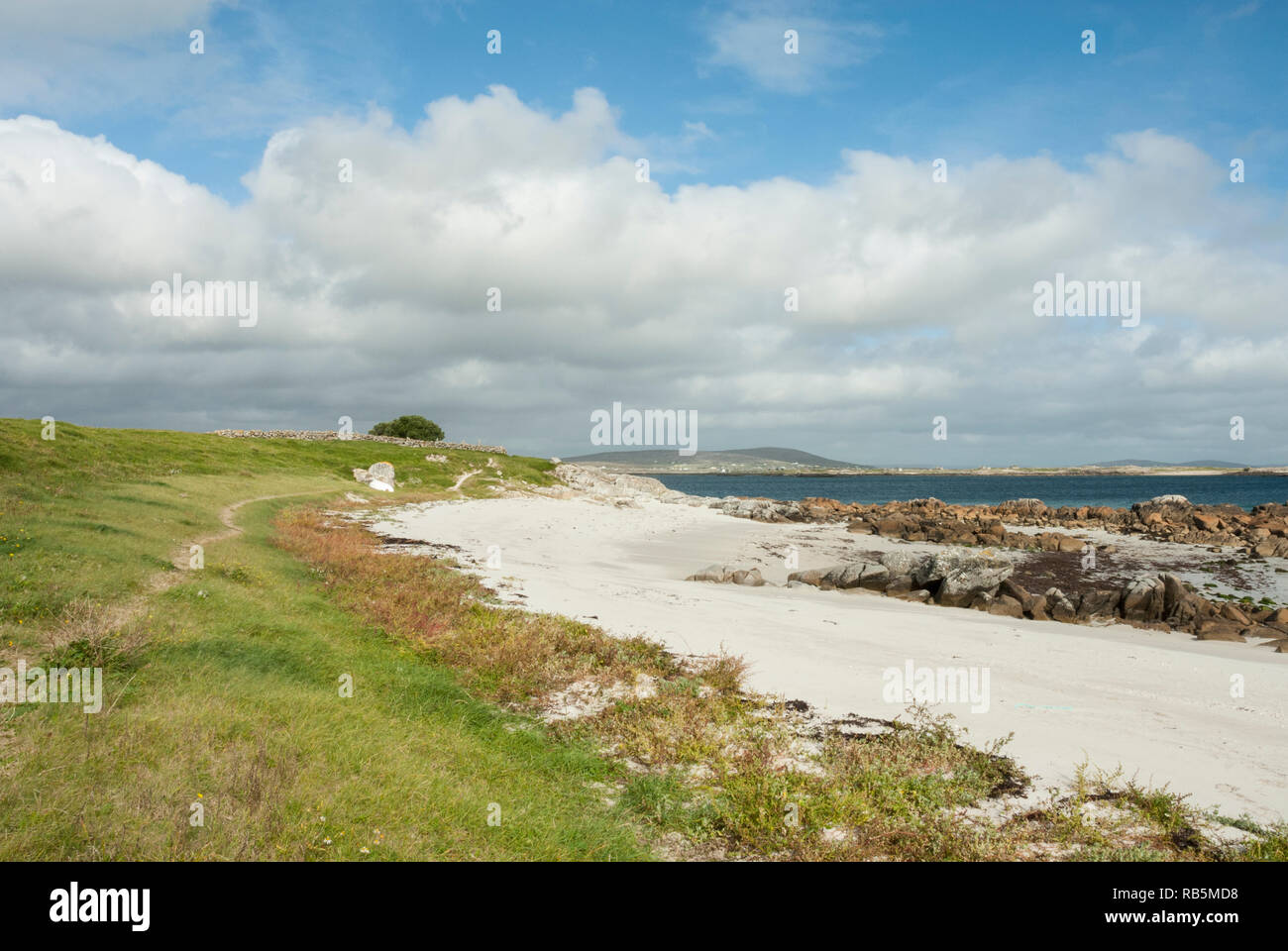The pristine golden sands of Mweenish Beach on a sunny day in late summer on Mweenish Island, ideal for swimming, walking and relaxing. - Stock Image