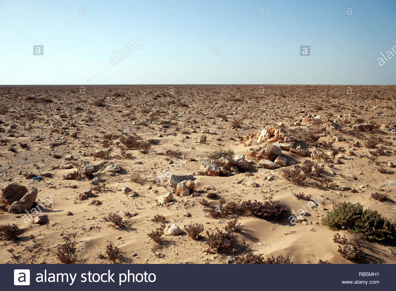 Stones and sand in Western Sahara - Stock Image