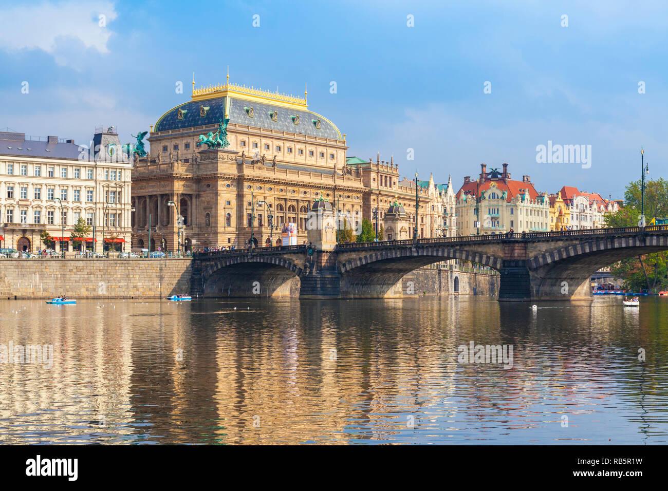 Prague National Theatre Národní divadlo and Legions' Bridge Most Legií and river Vltava Prague Czech republic Europe - Stock Image
