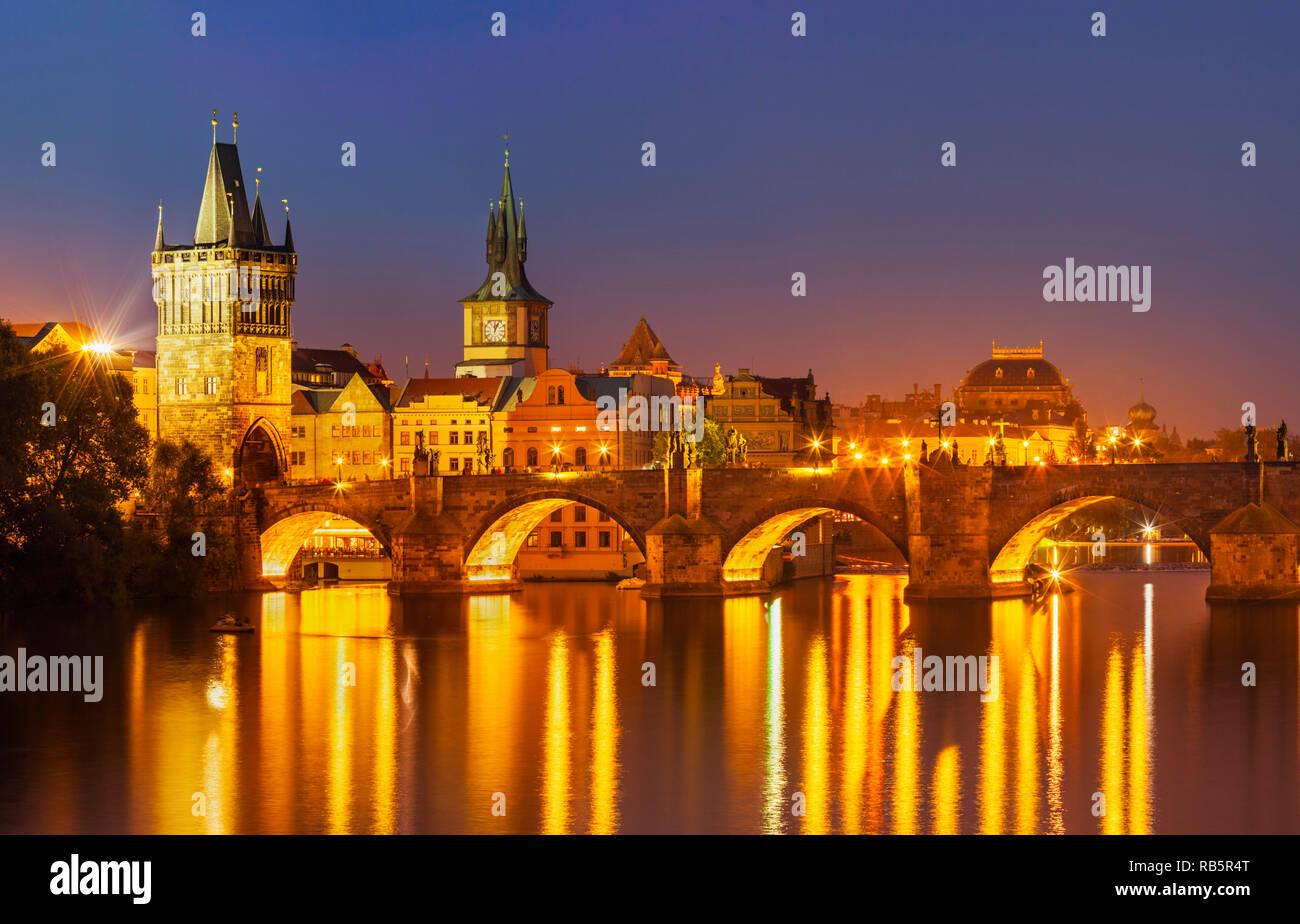 Prague Charles bridge, Old town bridge tower and river Vltava at night Prague Czech republic EU Europe - Stock Image