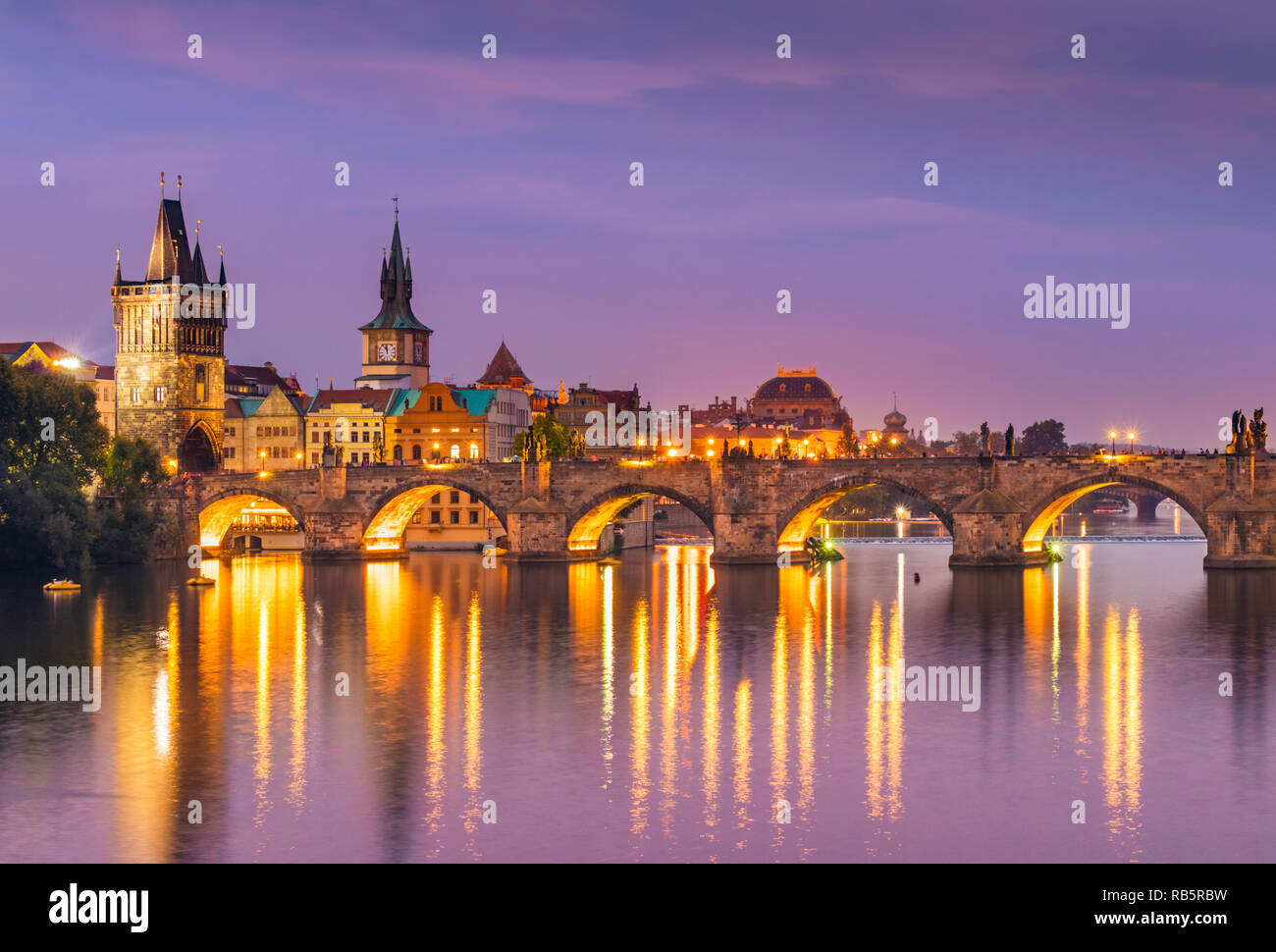 Charles Bridge Prague Charles bridge with old town bridge tower and river Vltava at night Prague Czech republic Europe - Stock Image