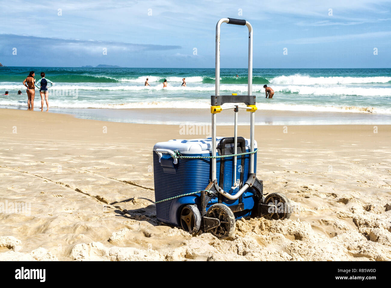 Cooler on the sand at Acores Beach. Florianopolis, Santa Catarina, Brazil. - Stock Image