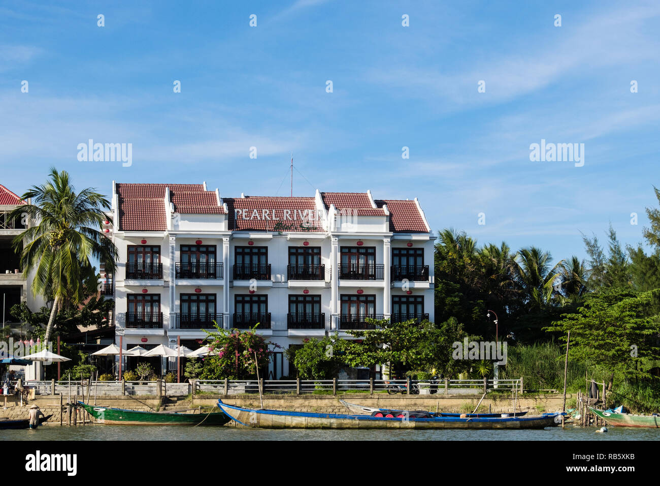 Front view of modern riverside Pearl River hotel and spa on Thu Bon River. Hoi An, Quang Nam Province, Vietnam, Asia.  Seen from the river - Stock Image