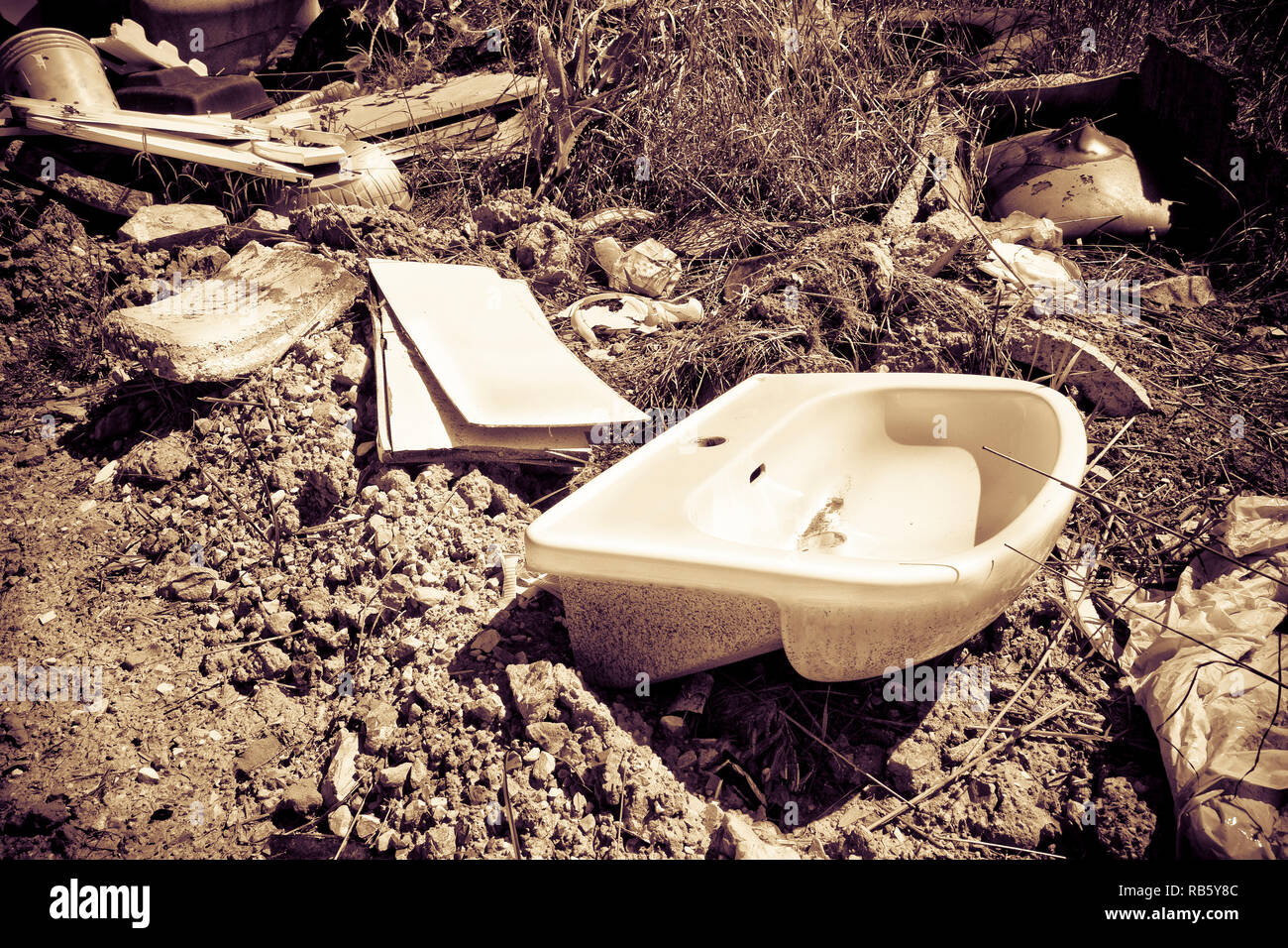 Illegal dumping: education and rudeness concept - toned image - Stock Image