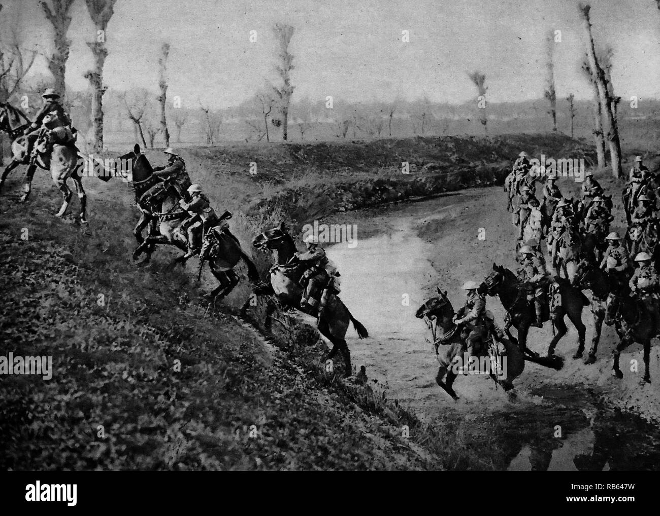 British cavalry charge across a river during World War One. - Stock Image