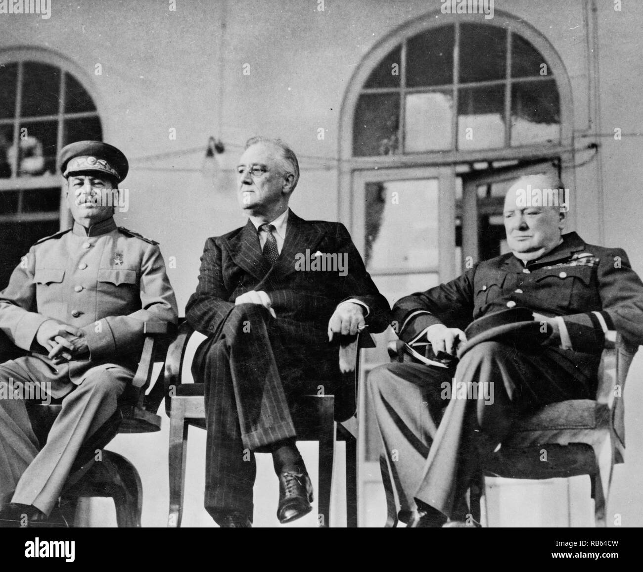 Photograph of American President Franklin Roosevelt, Russian Dictator Joseph Stalin, and British Prime Minister Winston Churchill during a conference in November. Dated 1943 - Stock Image