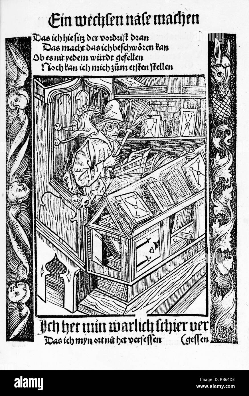Woodcut of a Medieval book collector sitting at a desk reading. Dated 1494 - Stock Image