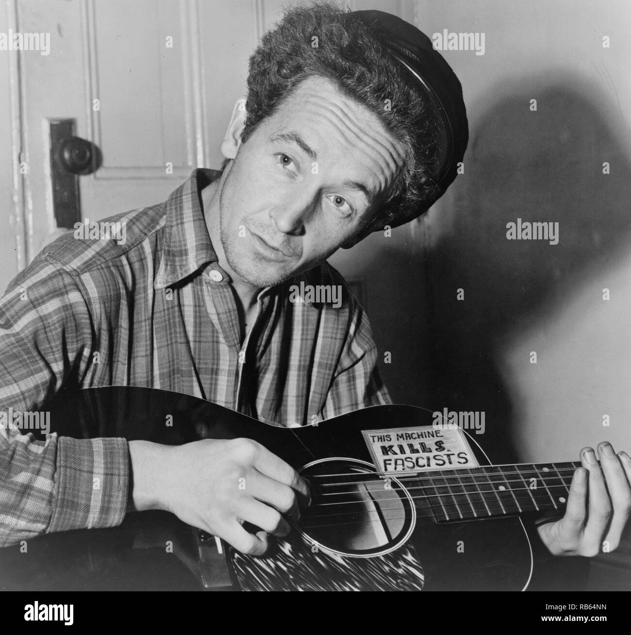 Portrait photograph of Woody Guthrie (Woodrow Wilson Guthrie) (1912-1967) American singer-songwriter. Dated 1943 - Stock Image