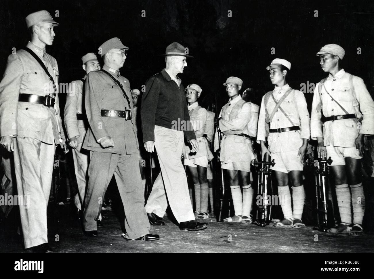 Lt. Gen. Joseph W. Stilwell inspecting Chinese troops in India, accompanied on his right by General Sun Li Zen and Lo. The former is the commanding general and the latter deputy chief of staff of the Chinese expeditionary forces. 1942. - Stock Image