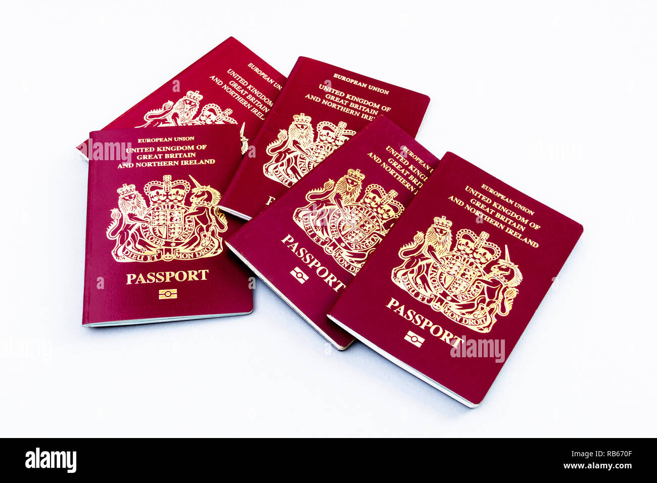 A group of five United Kingdom EU passports isolated on a white background Stock Photo