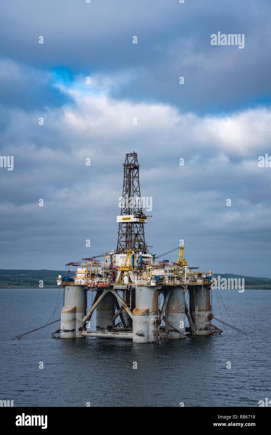 Offshore oil drilling platforms anchored in Cromarty Firth near Invergordon, Scotland, United Kingdom, Europe. - Stock Image