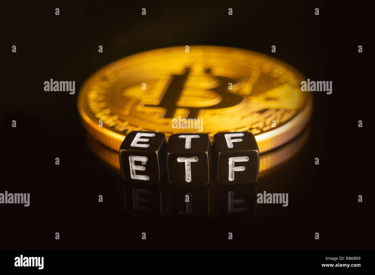 Bitcoin Exchange-traded fund ETF launch concept with coins and letters Stock Photo
