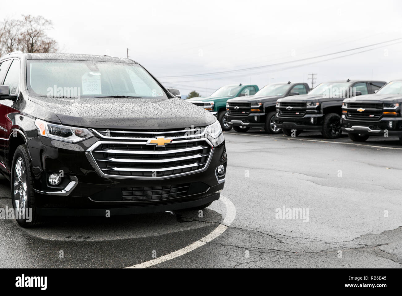 New Chevrolet (Chevy) Sport Utility Vehicles (SUV) and pick-up trucks on a dealer lot in Wilkes-Barre, Pennsylvania, on December 30, 2018. - Stock Image