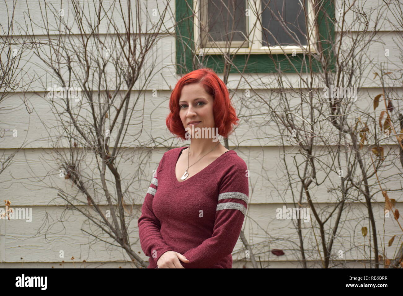 Pretty Red Haired Lady - Stock Image