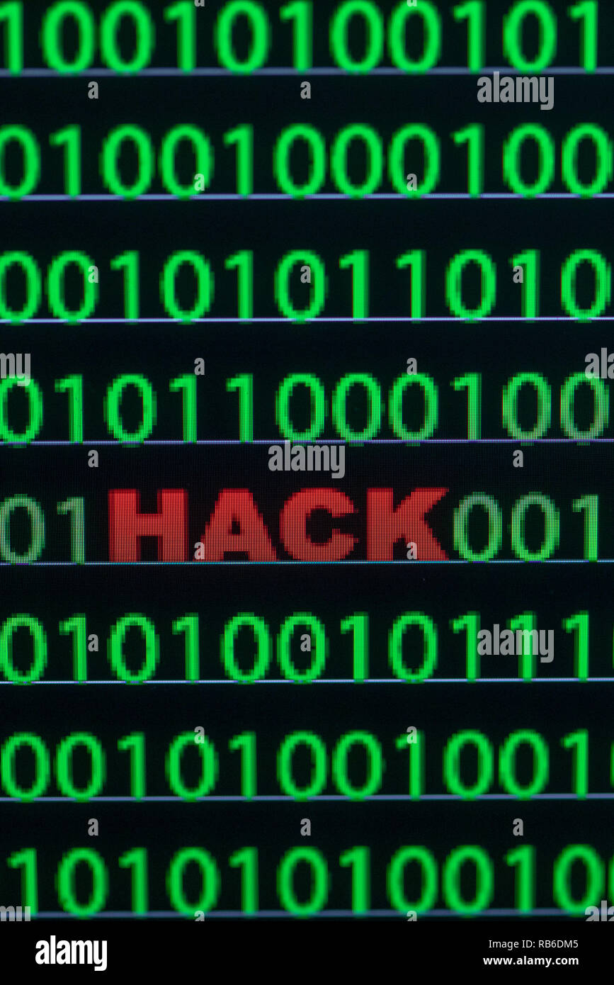 "04 January 2019, Germany (German), Schwerin: Between the binary code on a laptop monitor you can see the English word ""Hack"" (German: gehackt) (ILLUSTRATION/ posed photo). Photo: Jens Büttner/dpa-Zentralbild/ZB Stock Photo"