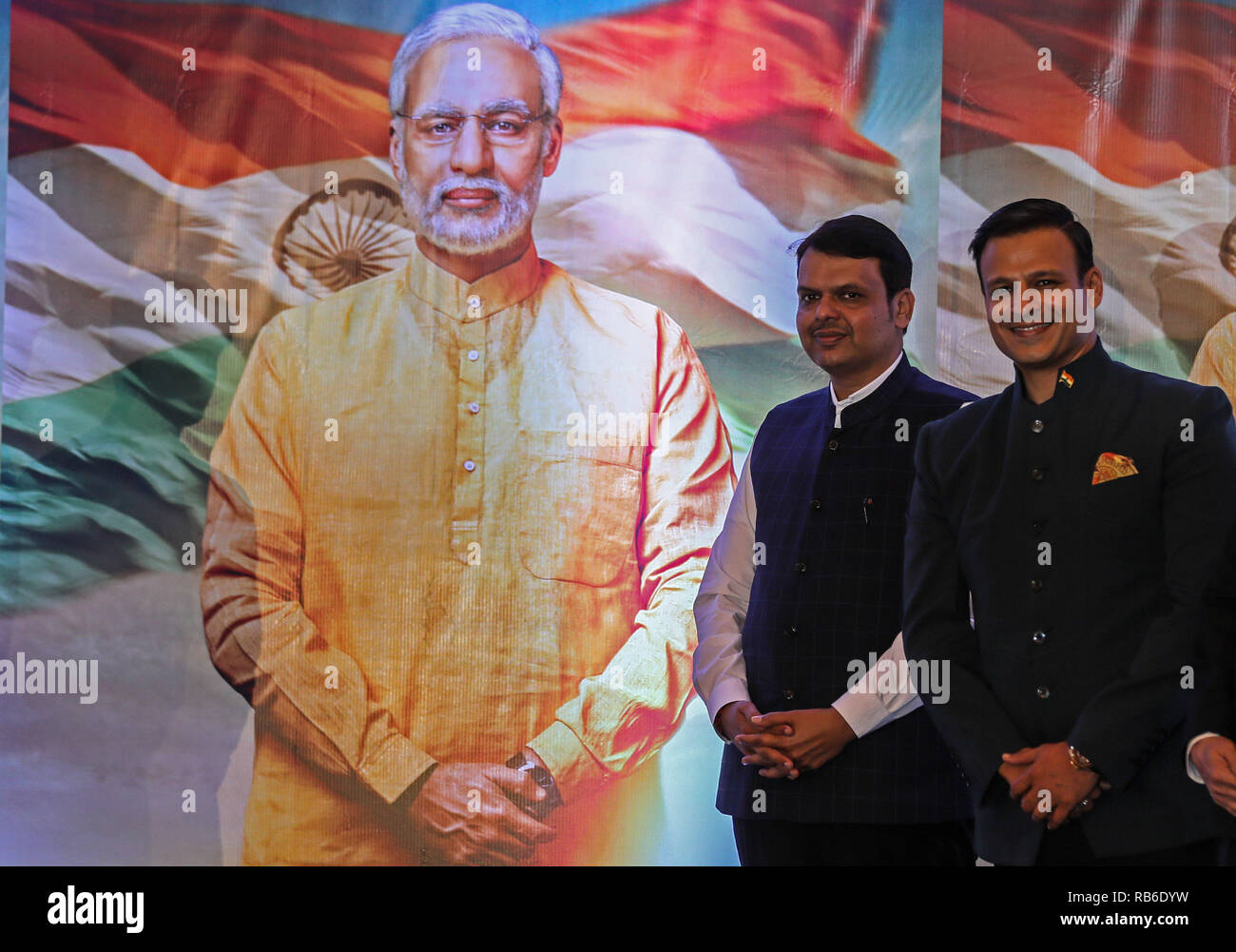Mumbai, India. 7th Jan, 2019. Maharashtra State's Chief Minister Devendra Fadnavis (L) and Bollywood actor Vivek Oberoi pose for photos during the poster launch of upcoming film 'PM Narendra Modi', a biopic on Indian Prime Minister Narendra Modi, in Mumbai, India, Jan. 7, 2019. Vivek Oberoi portrays the character of Indian Prime Minister Narendra Modi in the film. Credit: Stringer/Xinhua/Alamy Live News - Stock Image
