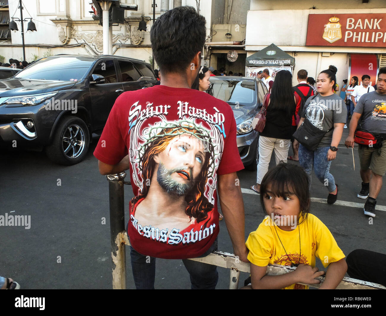 A father and her daughter are seen wearing Black Nazarene T