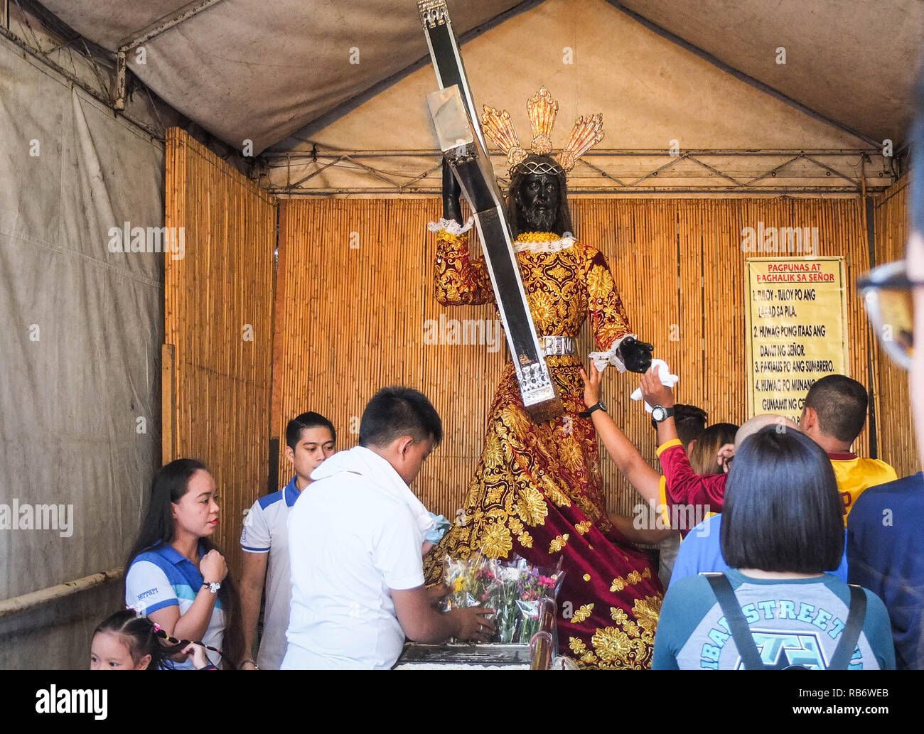 Catholic devotees are seen wiping the holy cloth and the