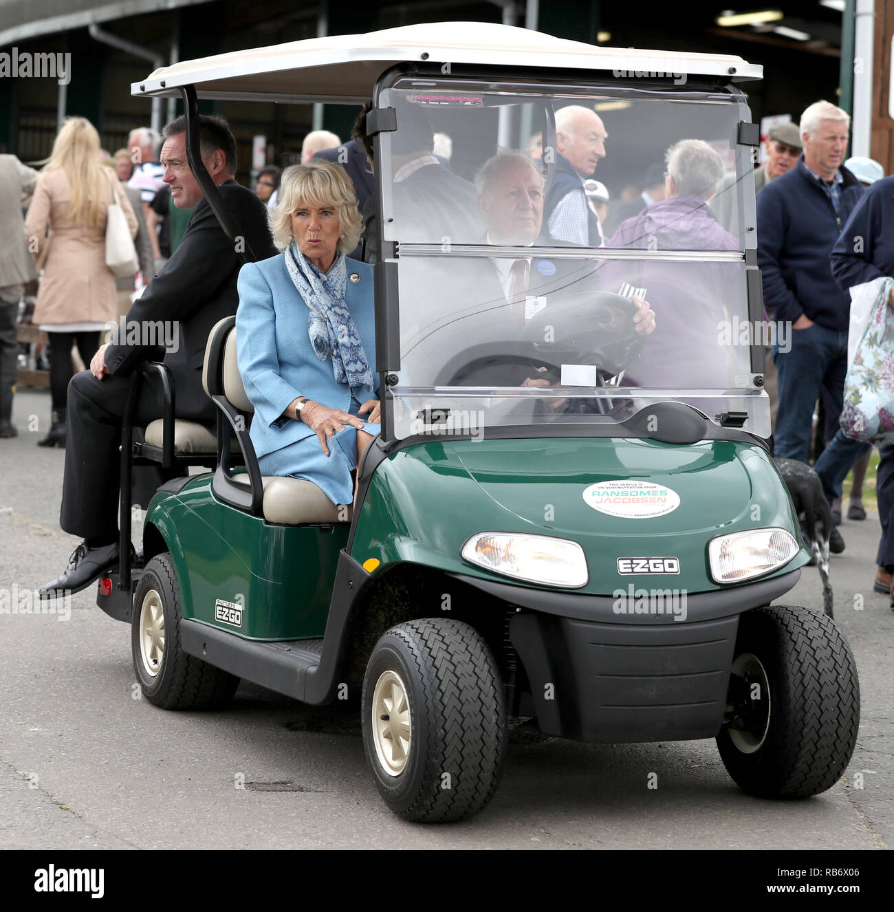 The Duchess of Cornwall, President of The South of England Show rides on a golf buggy during a tour of the Show held at the show ground near Ardingly, - Stock Image