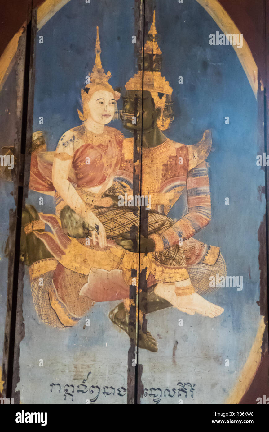 Painting of a mythical beast and a princess on wooden window shutter in the Hall of Bronzes, National Museum, Phnom Penh, Cambodia - Stock Image