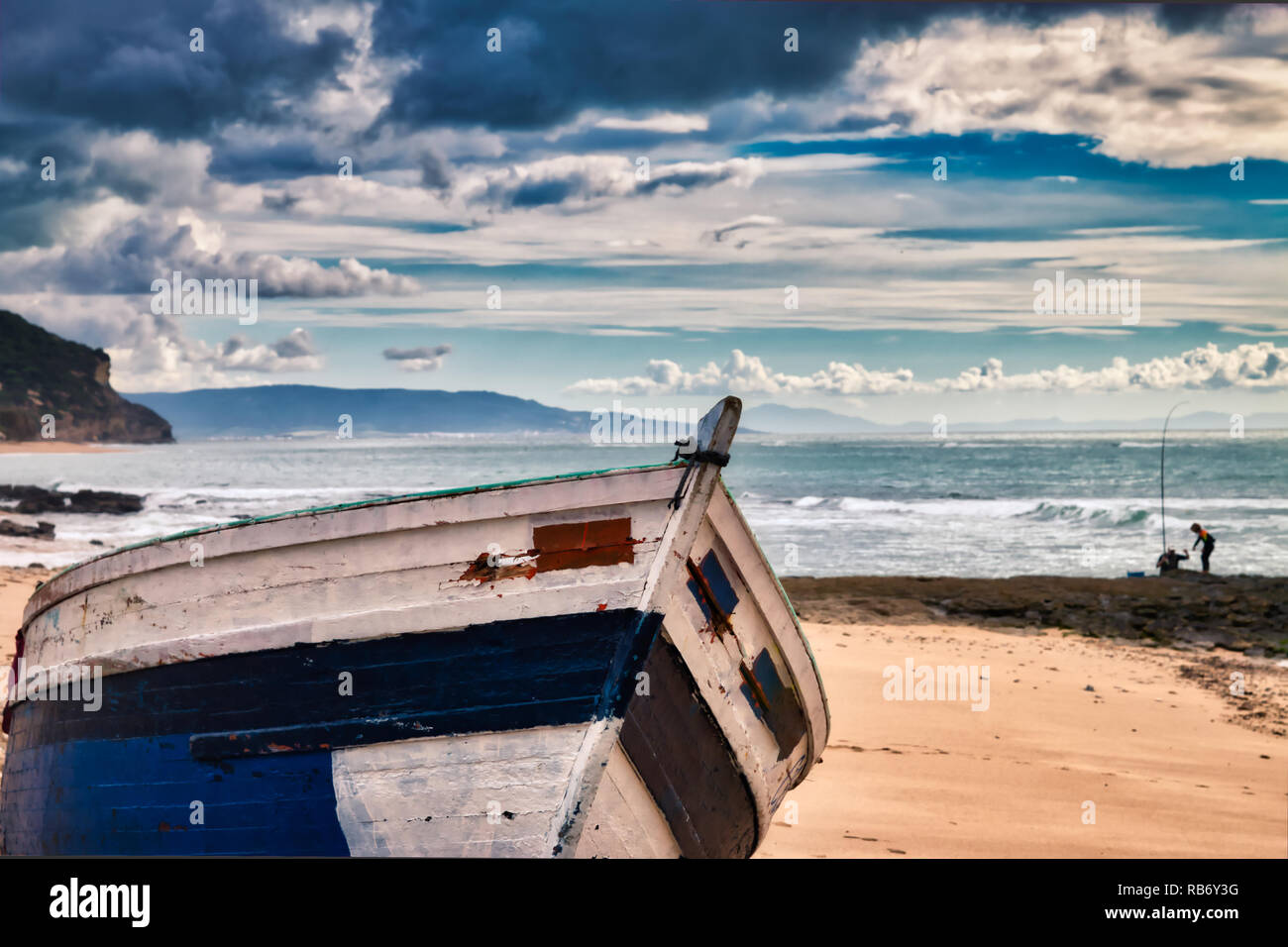 Boat stranded on the Caños de Meca beach  a stormy day Stock Photo
