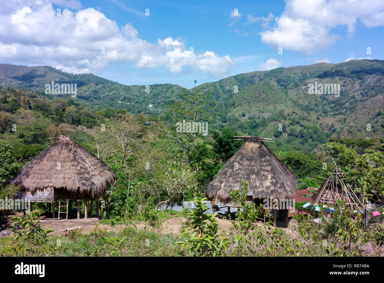 Traditional homes in the mountains of central Timor Leste. Stock Photo