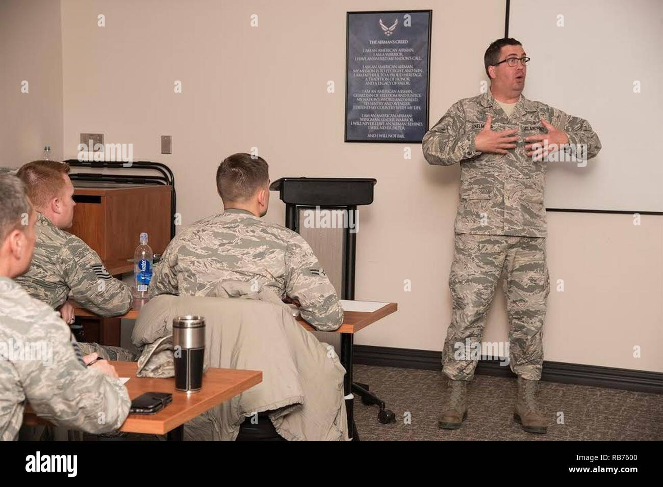 PETERSON AIR FORCE BASE, Colo. - Tech. Sgt. Thomas Echlemeyer, 21st Aerospace Medicine Squadron Bioenvironmental Engineering NCO in charge and 5/6 Club president, compares Generation X and millennial characteristics during the Millennial Leadership Course on Dec. 9, 2016, at the Professional Development Center, Peterson Air Force Base, Colo. The course was designed by Peterson's 5/6 Club as a facilitated discussion group to provide guidance on how to lead millennial Airmen and new generations entering the Air Force. - Stock Image