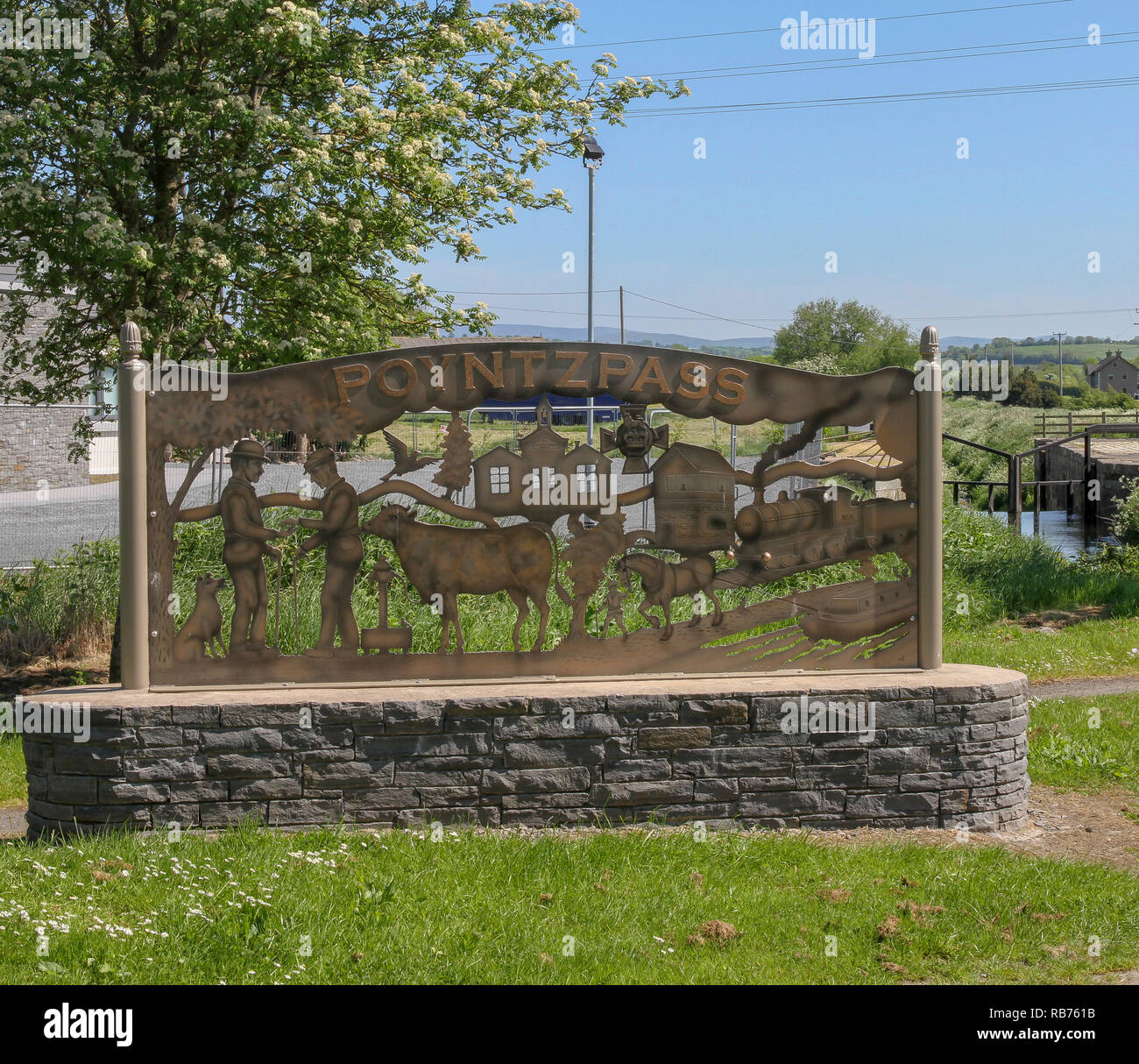 Northern Ireland village sign at Poyntzpass, County Down providing historical information on the village on the Newry Canal. - Stock Image