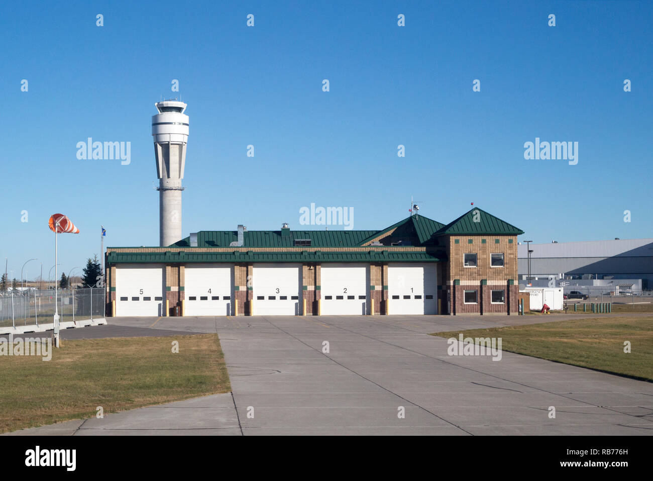 Emergency response services building and control tower at the Calgary International Airport - Stock Image