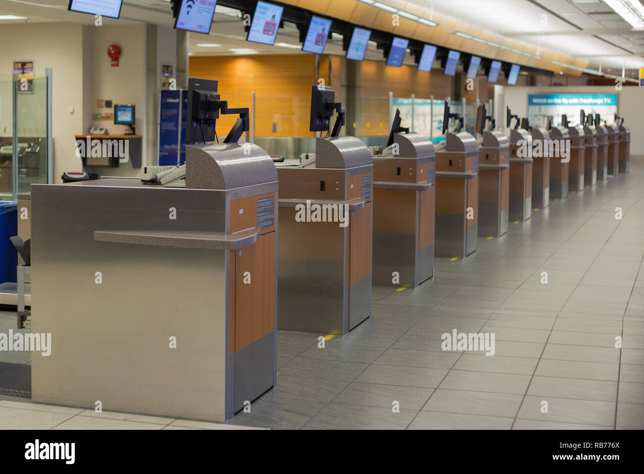 Row of check-in counters at the Calgary International Airport - Stock Image