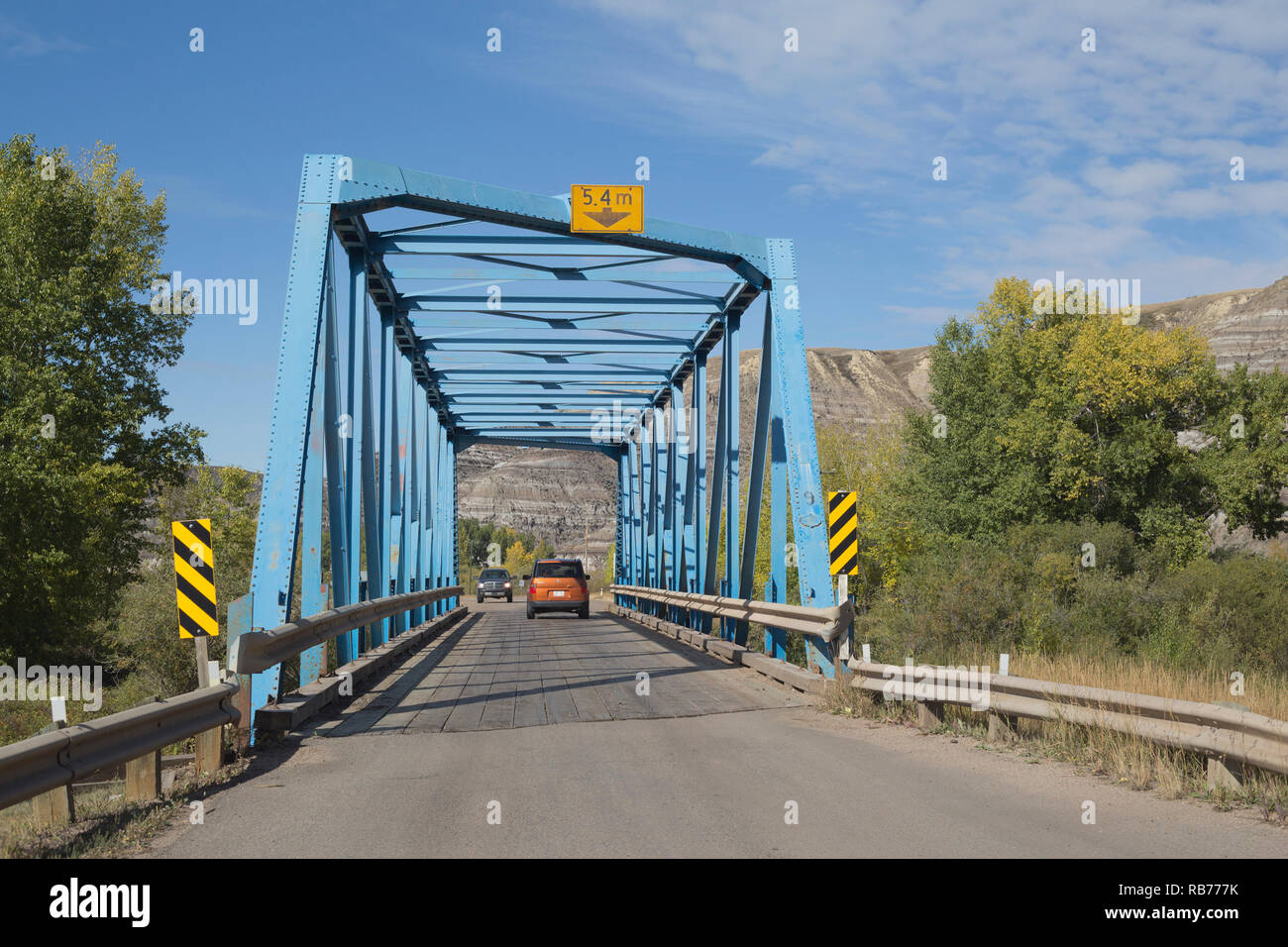 Trucks driving across one lane metal bridge, #9 of a series of 11 bridges across the Rosebud River on a 6 kilometer stretch from Rosedale to Wayne - Stock Image