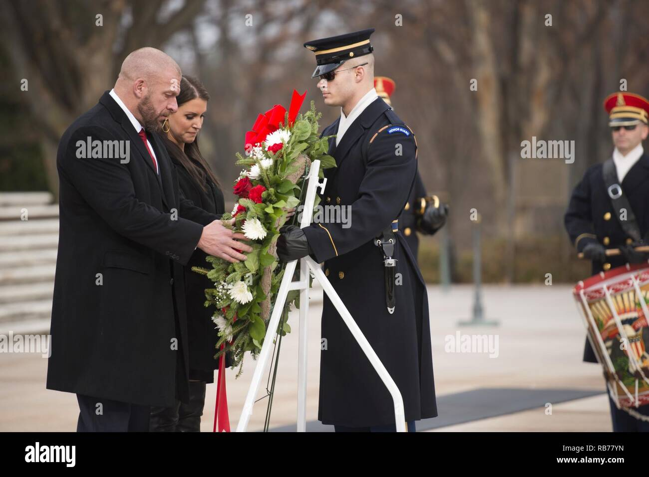 """From the left, WWE Paul """"Triple H"""" Levesque and WWE Chief Brand Officer Stephanie McMahon place a wreath at the Tomb of the Unknown Soldier in Arlington National Cemetery, Dec. 13, 2016, in Arlington, Va. WWE is scheduled to host its 14th annual Tribute to the Troops, in partnership with the USO Metro, in Washington, D.C. - Stock Image"""