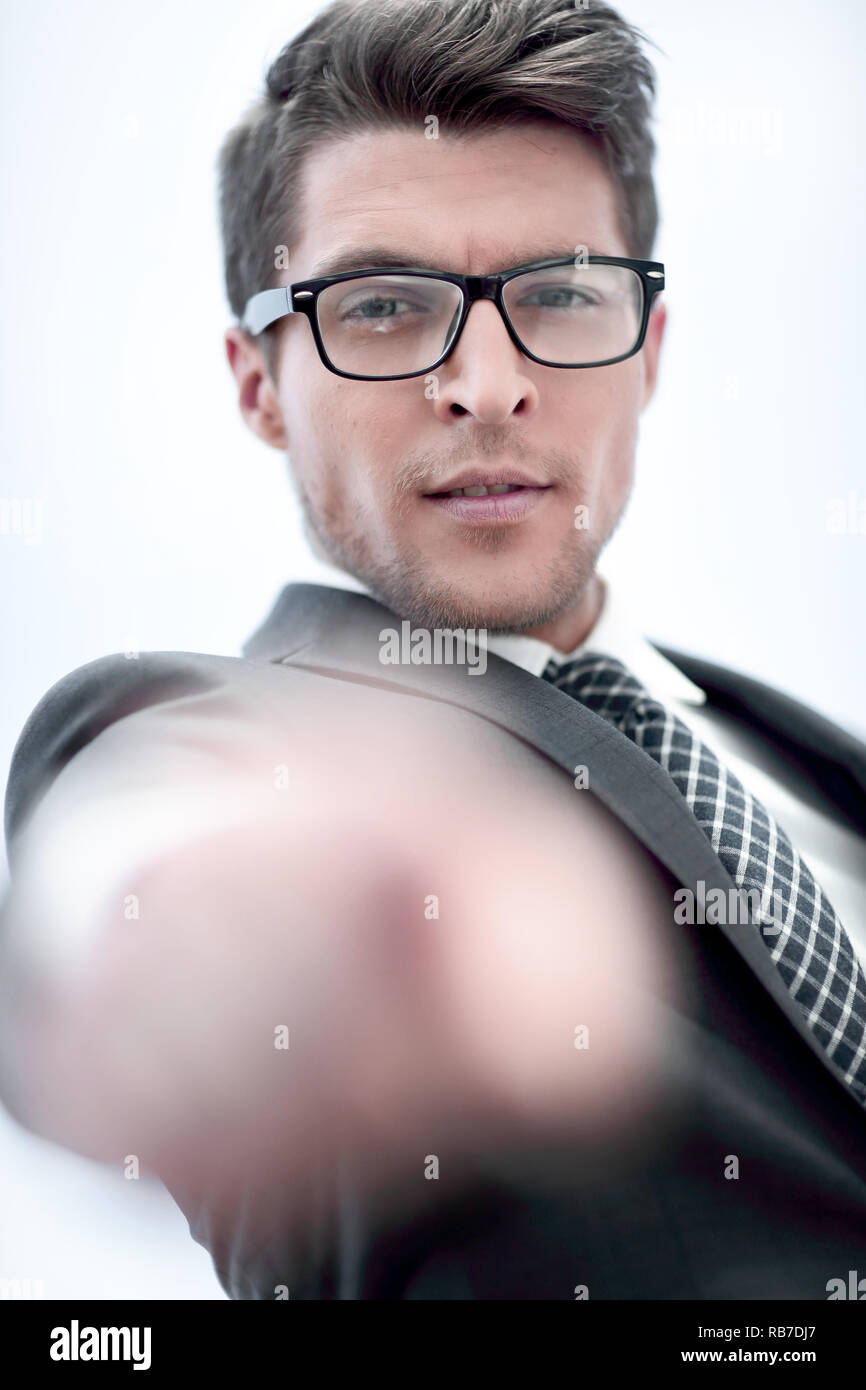close up.successful businessman pointing his finger at you - Stock Image