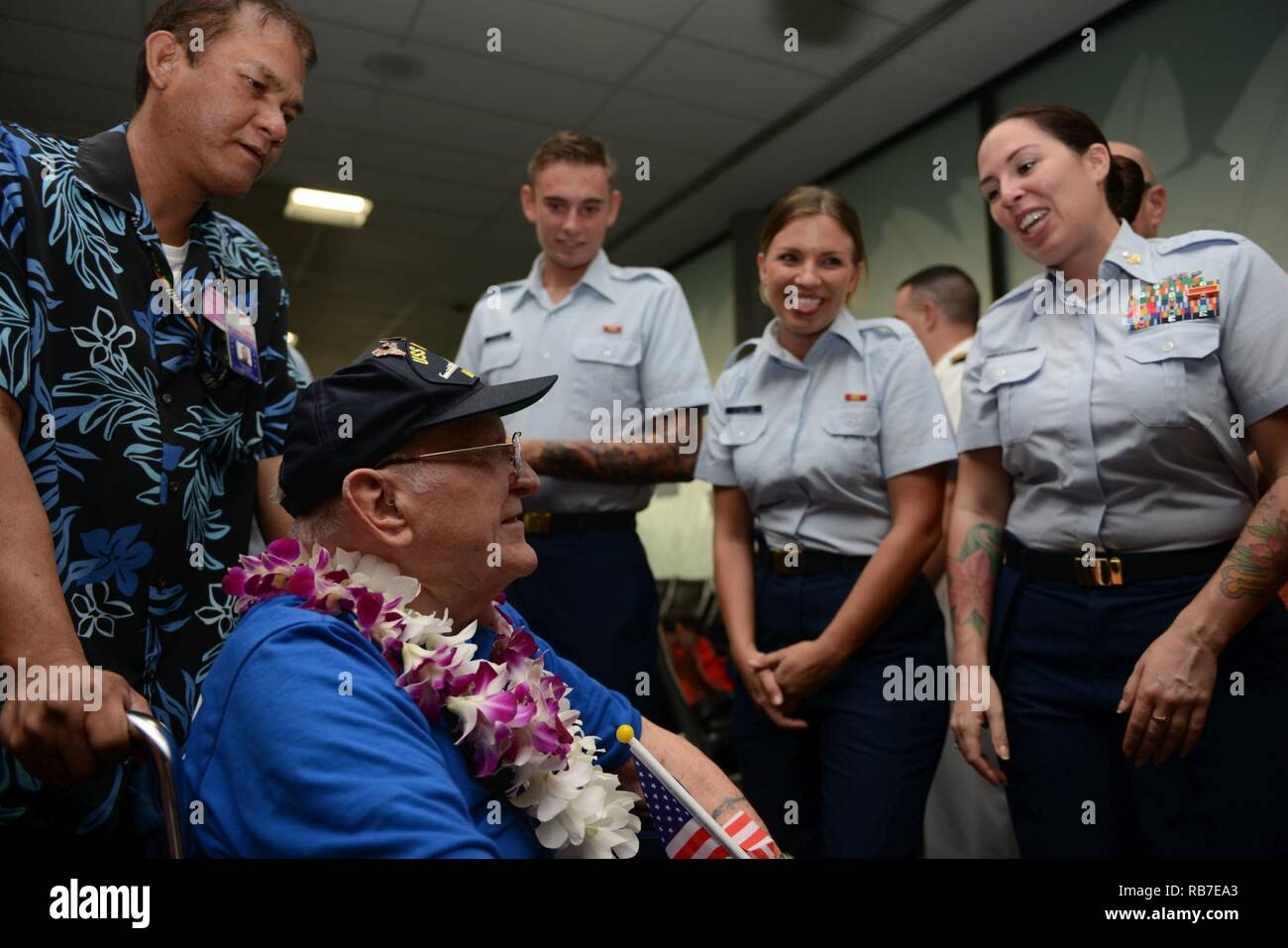 a world war ii is greeted by coast guard members and several other