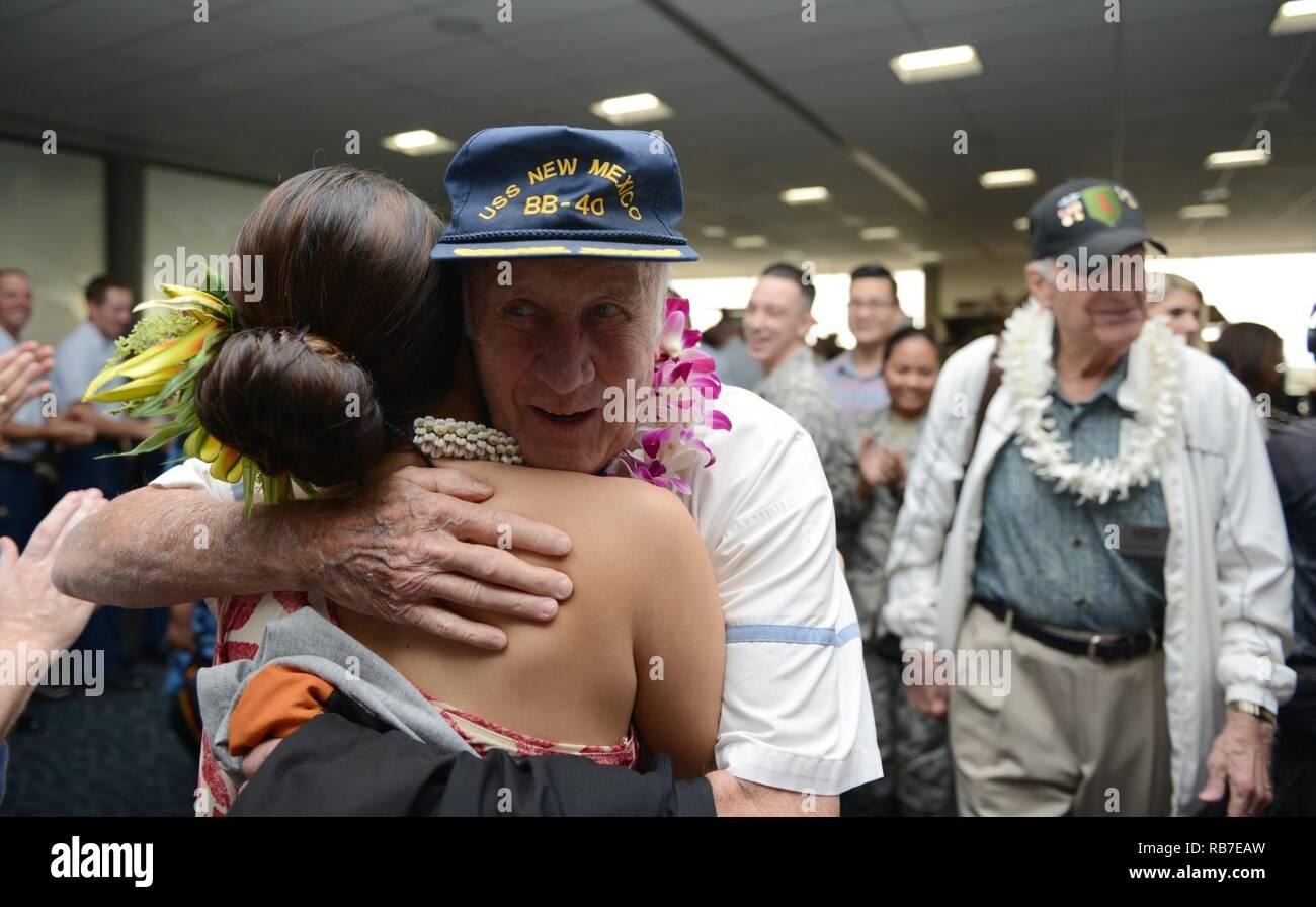 a world war ii veteran receives a hug after the arrival of an