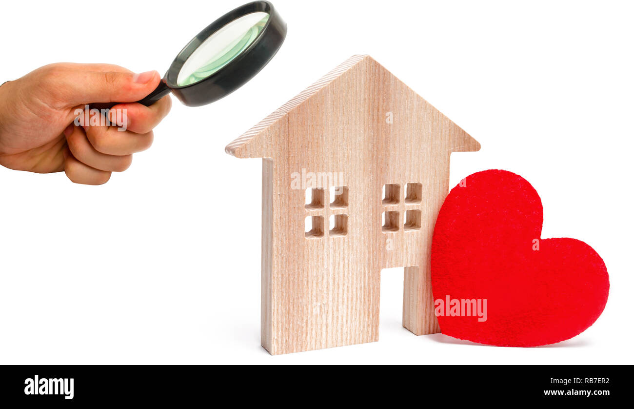 House with a red heart on an isolated white background. House of lovers. Affordable housing for young families. Valentine's day house. Home Sweet Home - Stock Image