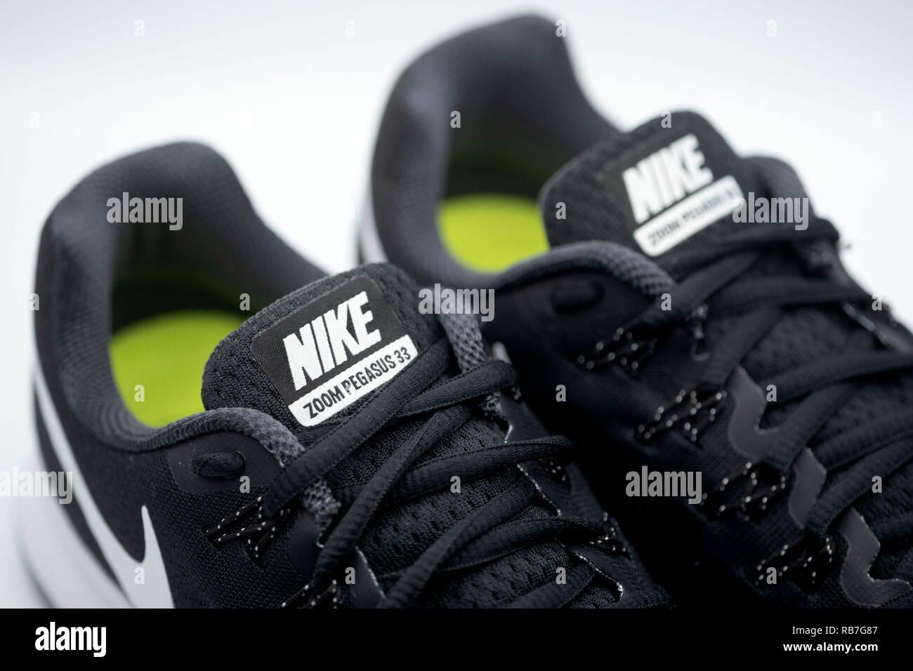 Black Nike Pegasus 33 running shoes on white background Stock Photo