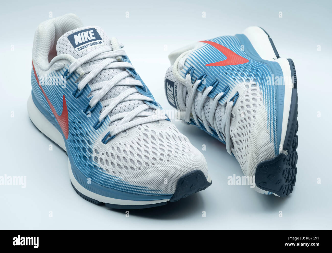 detailed look 2aaec e6fcc Pair of blue and white Nike Pegasus 34 running shoes - Stock Image