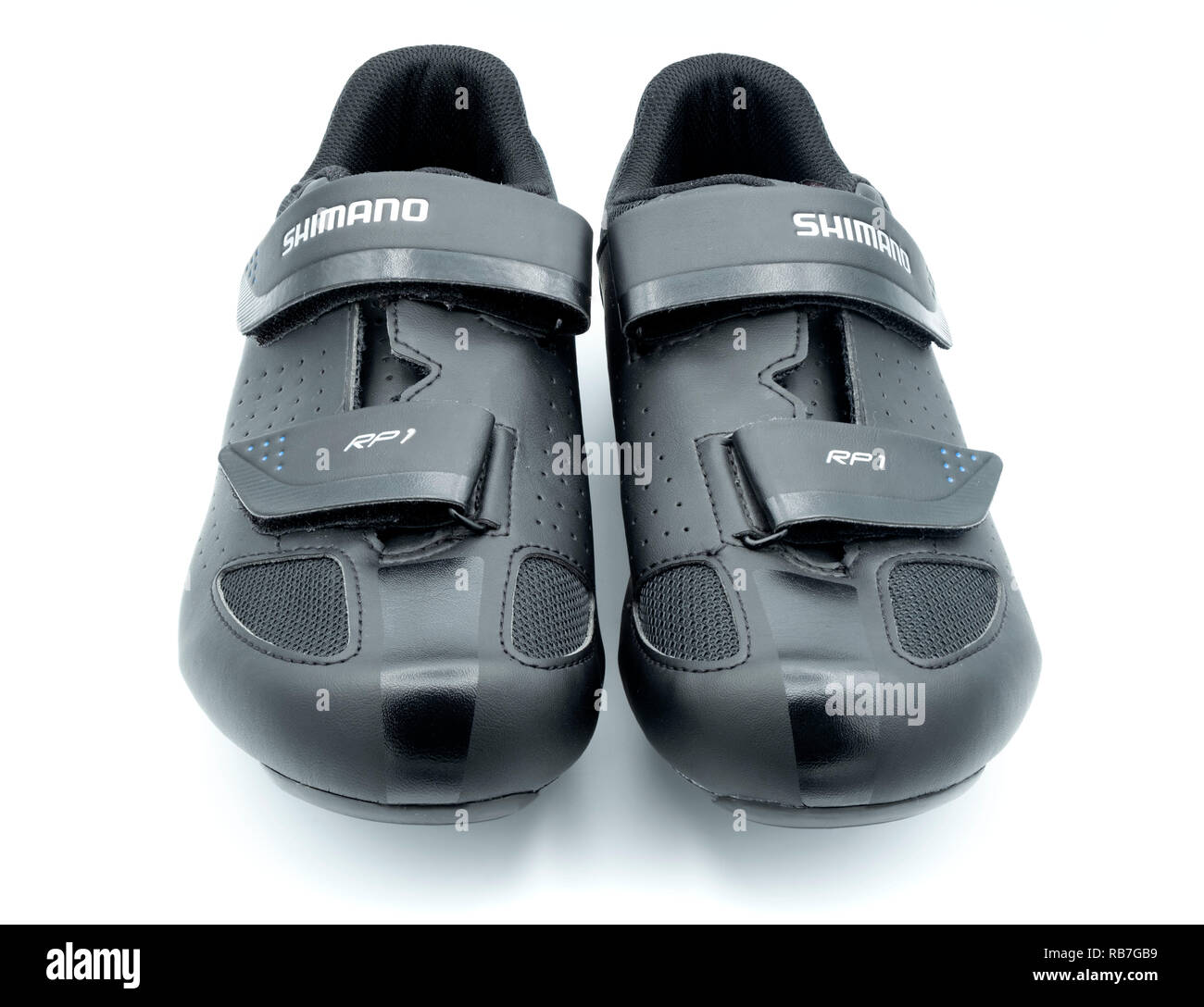 Pair of black Shimano road cycling / spinning class shoes - Stock Image