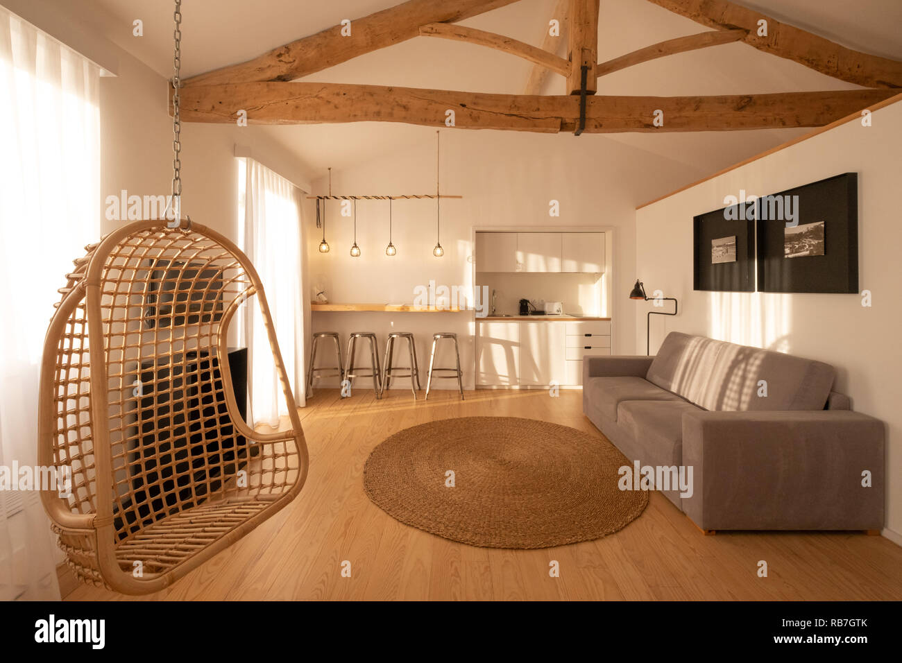 Brightly lit studio apartment with living room and ...