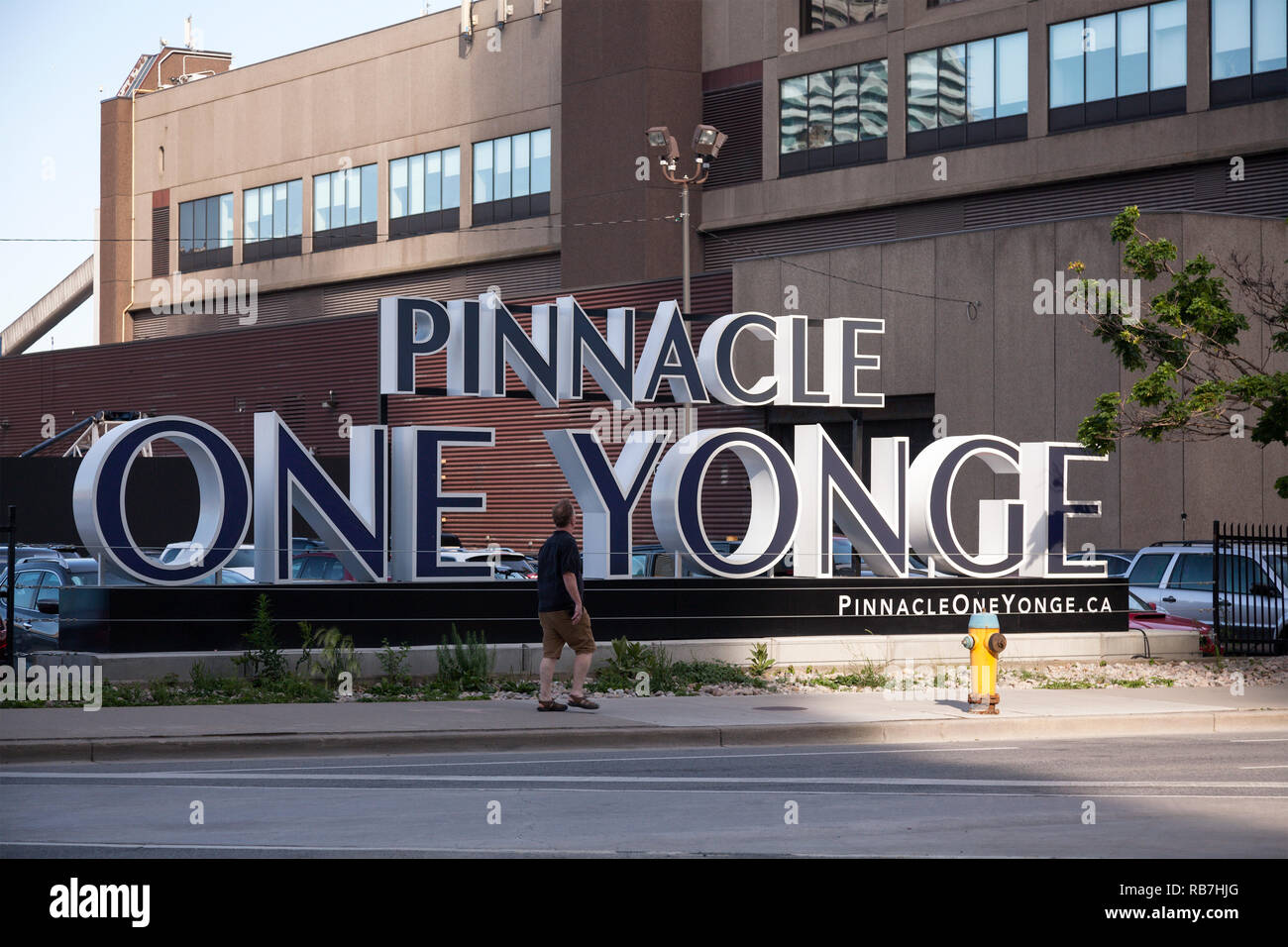 A sign for Pinnacle One Yonge, an upcoming development at the Toronto Star building (Torstar building) at One Yonge street. City of Toronto, Ontario. - Stock Image