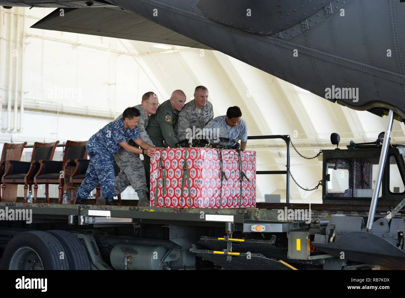 5e508c427d Leaders move a box of donated goods into the back of a C-130 Hercules